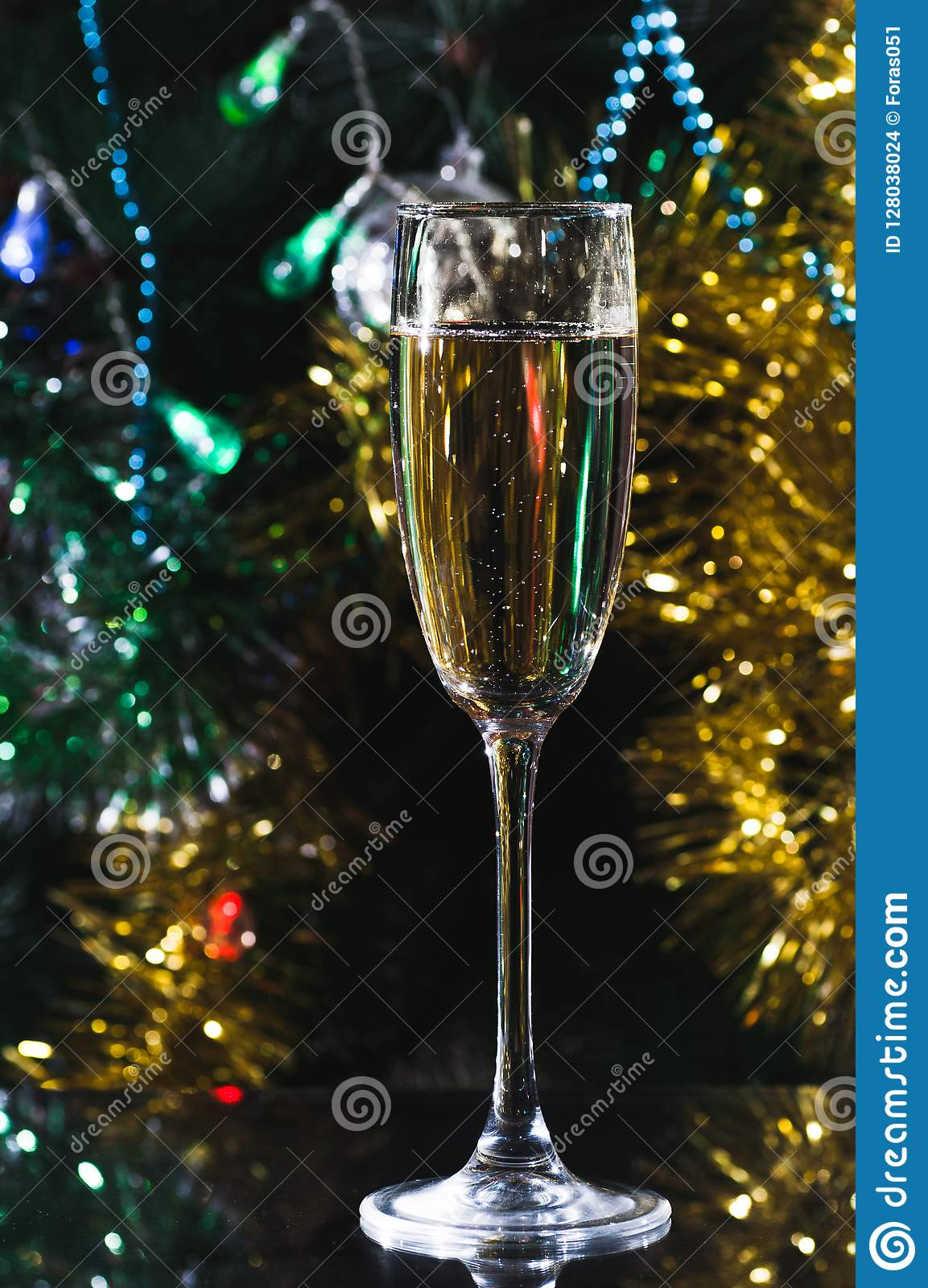 A glass of champagne under the Christmas tree