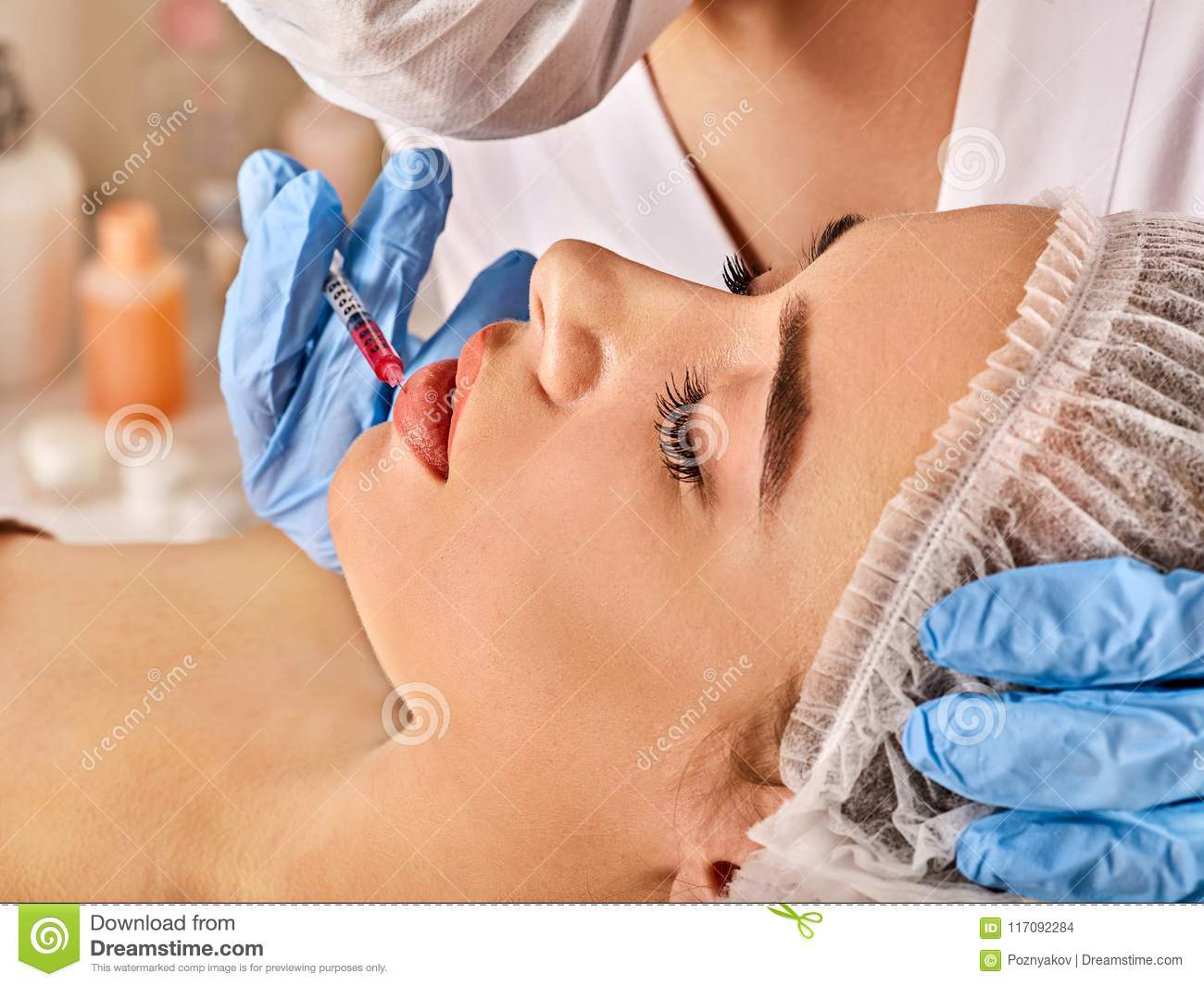 Dermal Fillers Lips Of Woman In Spa Salon With Beautician