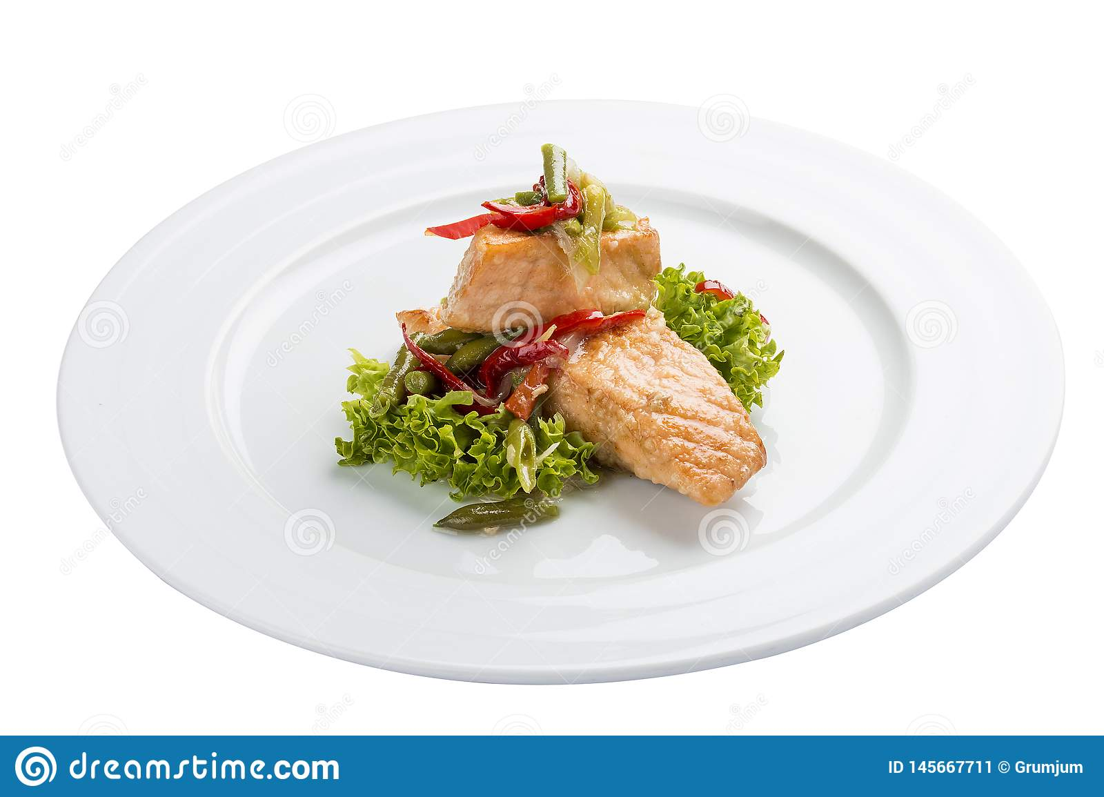 Fillet of baked salmon with salad.