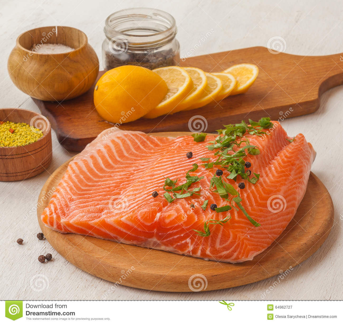 Fillet of red fish and lemon on a cutting board dof stock for Fish fillet board