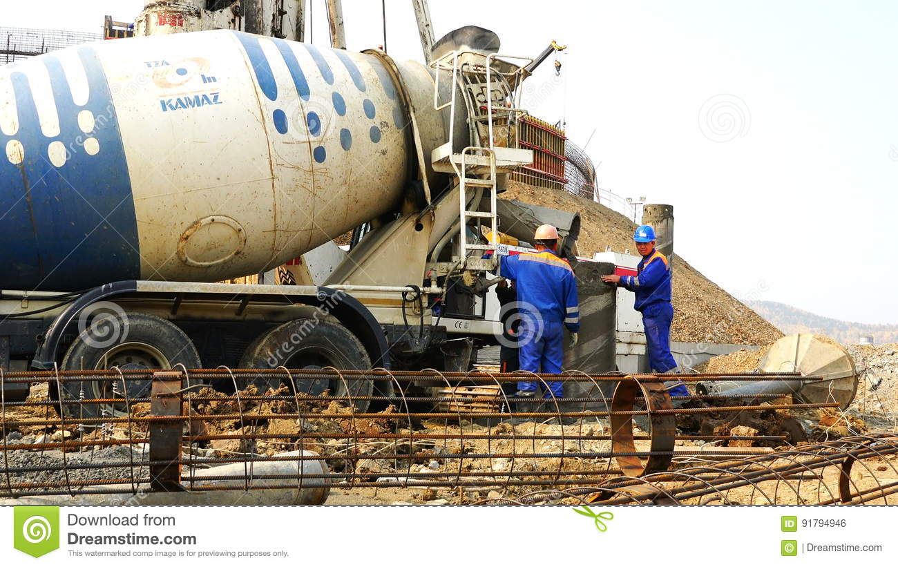 Filling concrete with casing mixer and well after concrete drilling