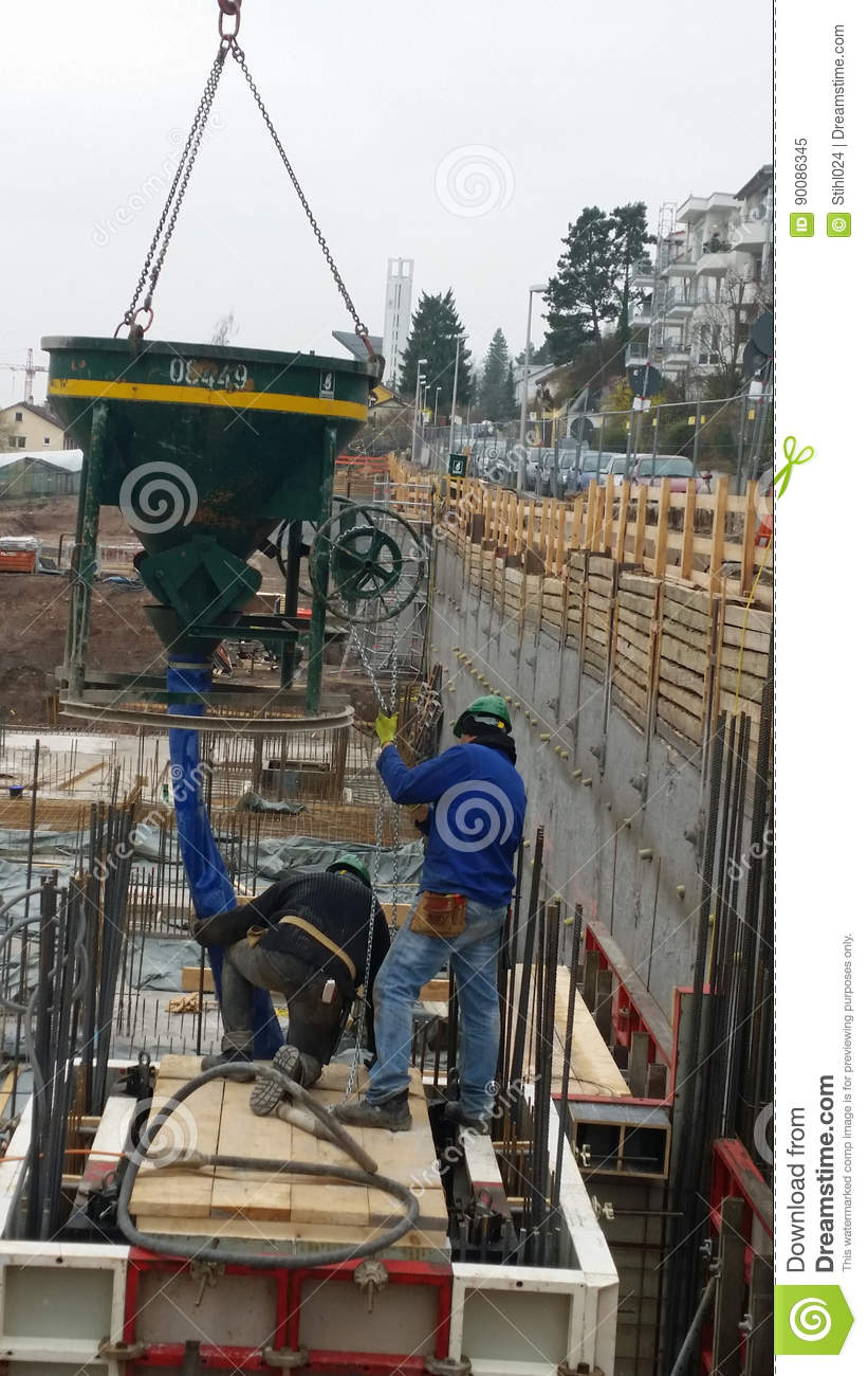 Filling Concrete Into Formwork Stock Image - Image of helmet