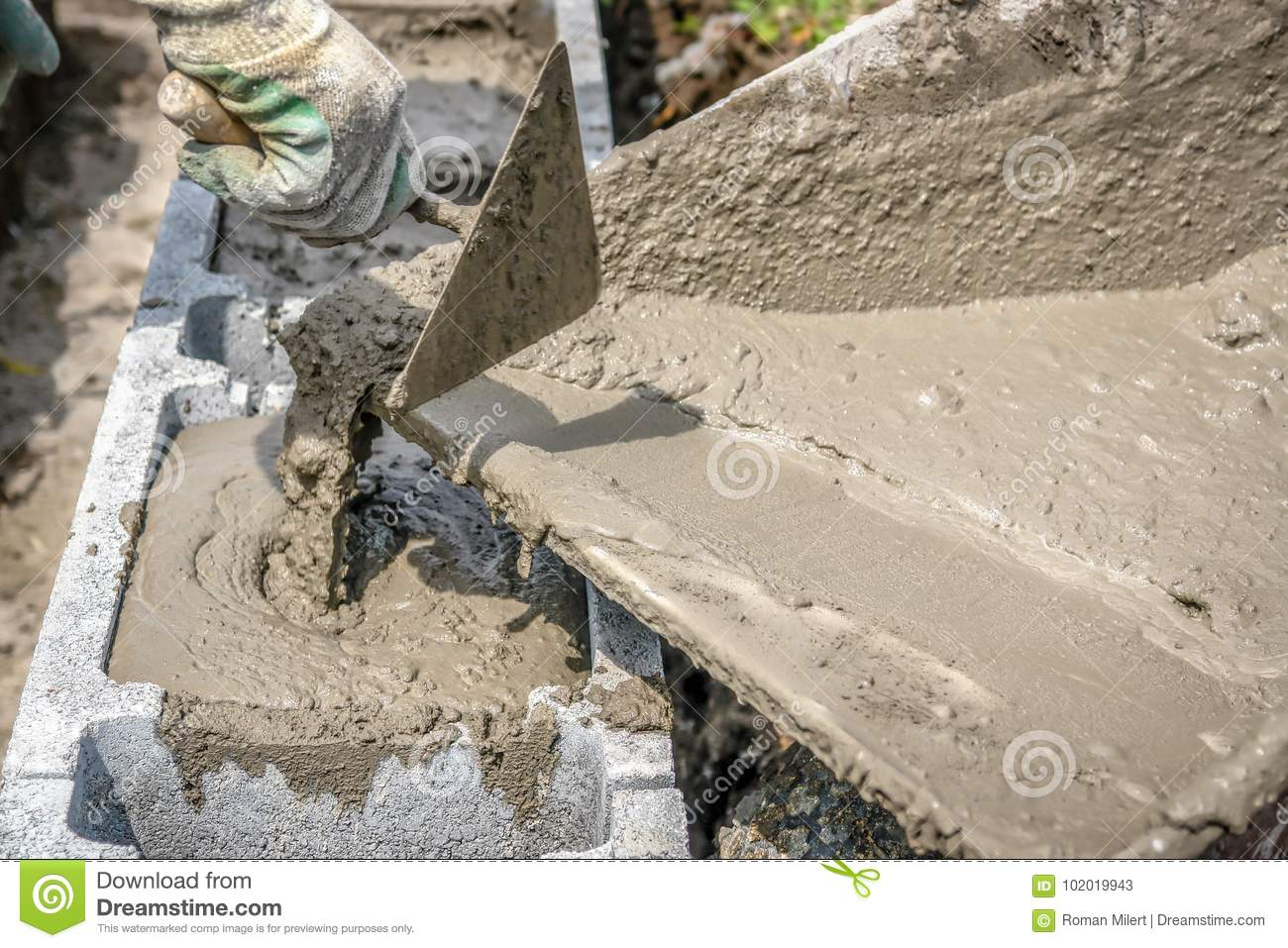 Filling Foundation Blocks With Mortar Stock Image - Image of