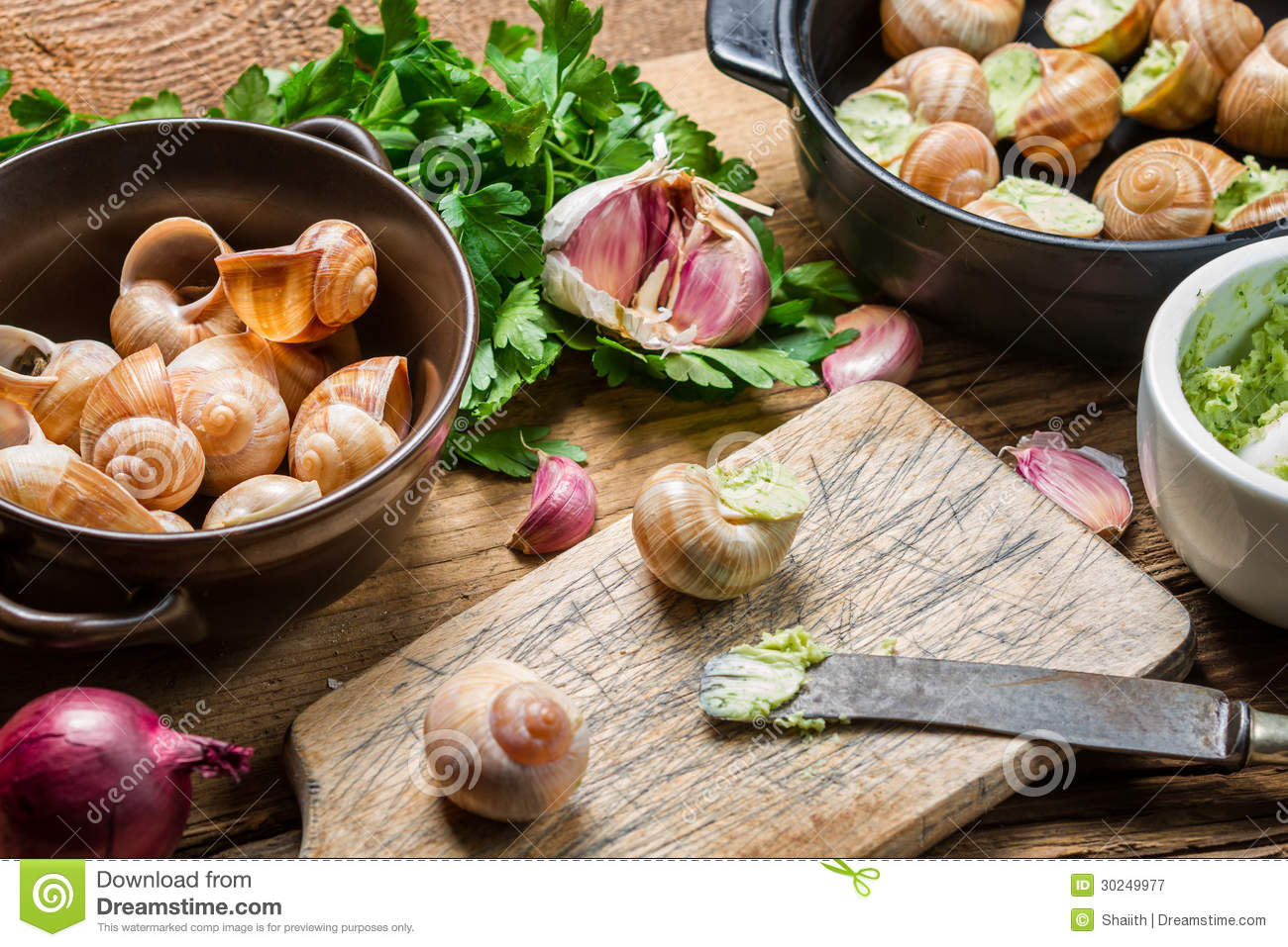 Filling Snails With Garlic Butter And Fresh Herbs Royalty Free Stock ...
