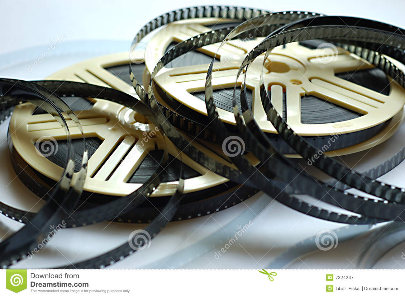Film reels on white background