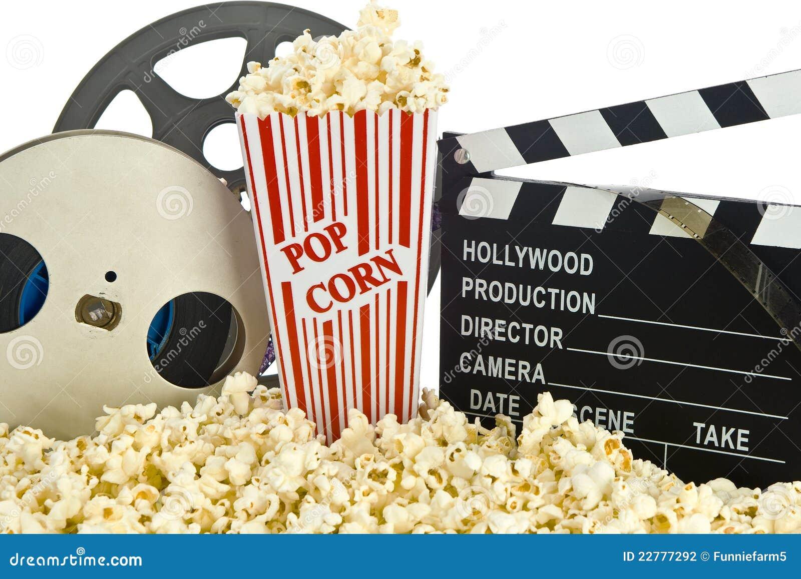 FilmClapperbräde i popcorn med filmrullen