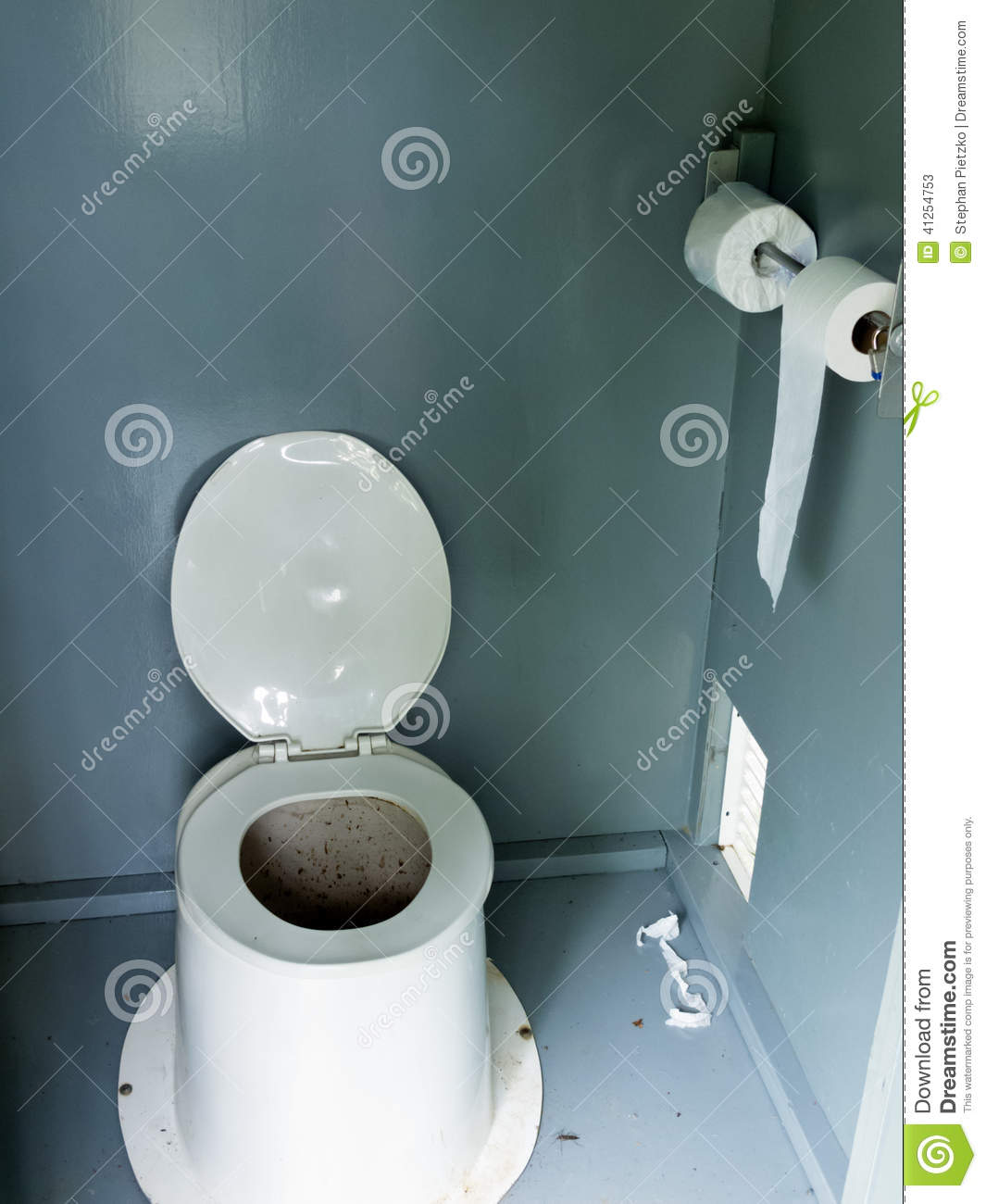 filthy camp ground latrine outhouse inside toilet stock