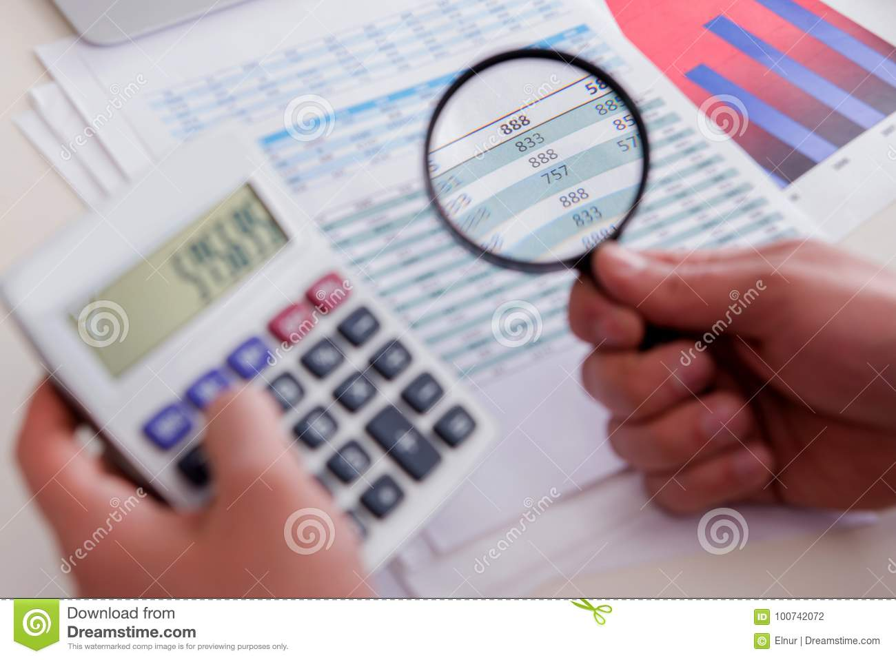 The finance analyst looking and financial reports