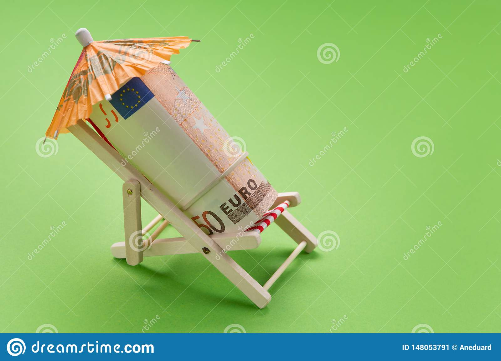 Finance concept, a roll of euro notes lying in a deck chair, under an umbrella, as if resting