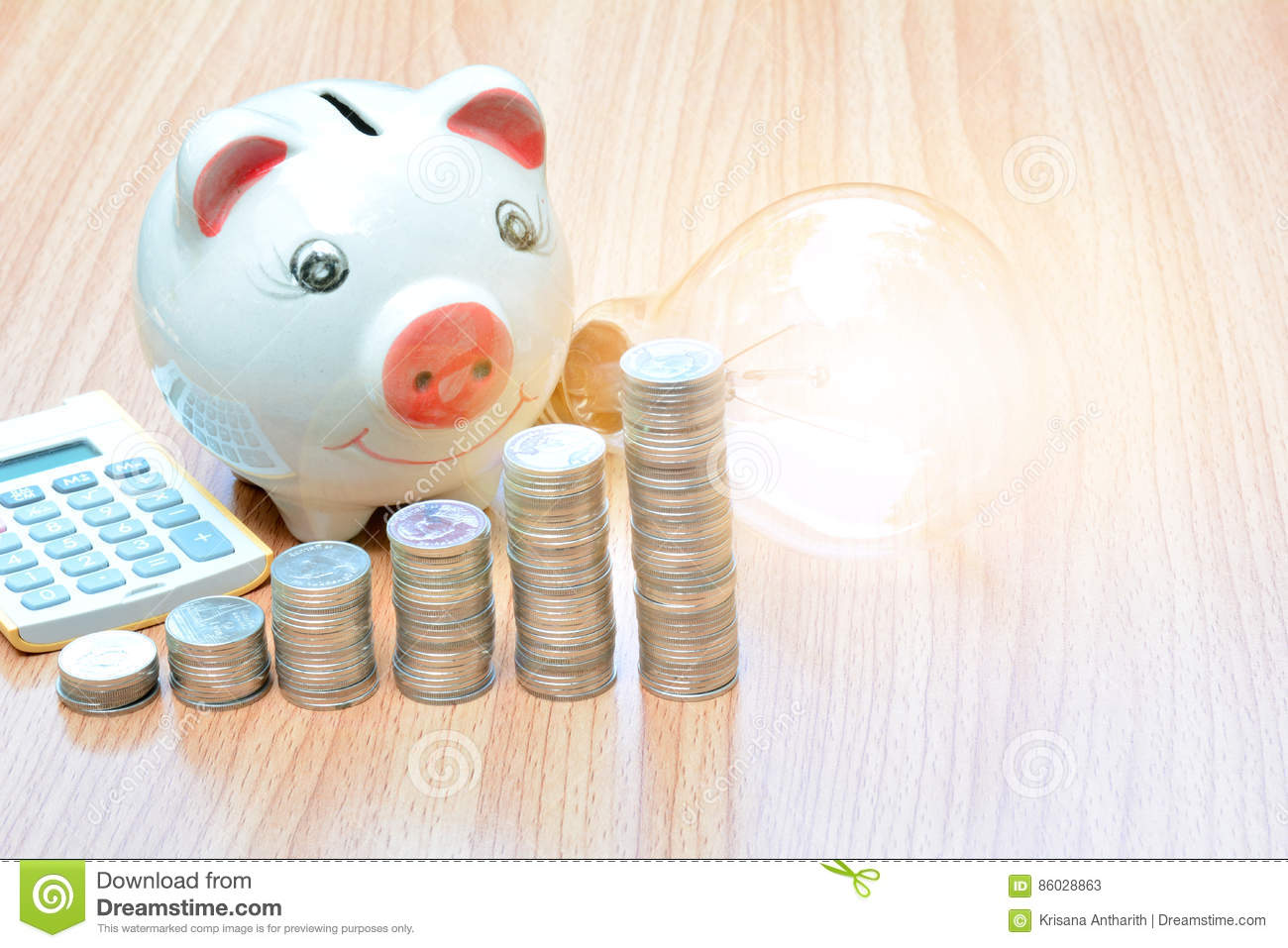 Finance stack coins and piggy bank on wood table