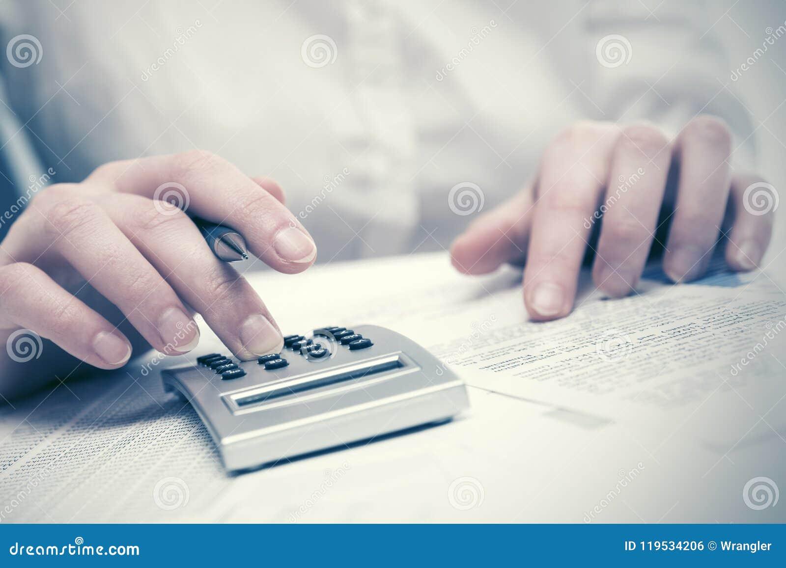 Financial accounting Business woman using calculator