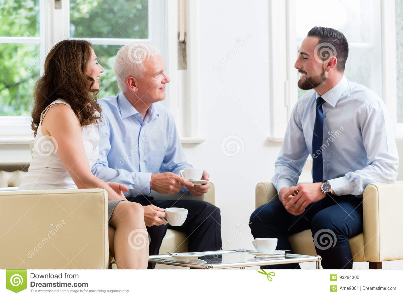 financial advisor consulting couple in retirement planning stock