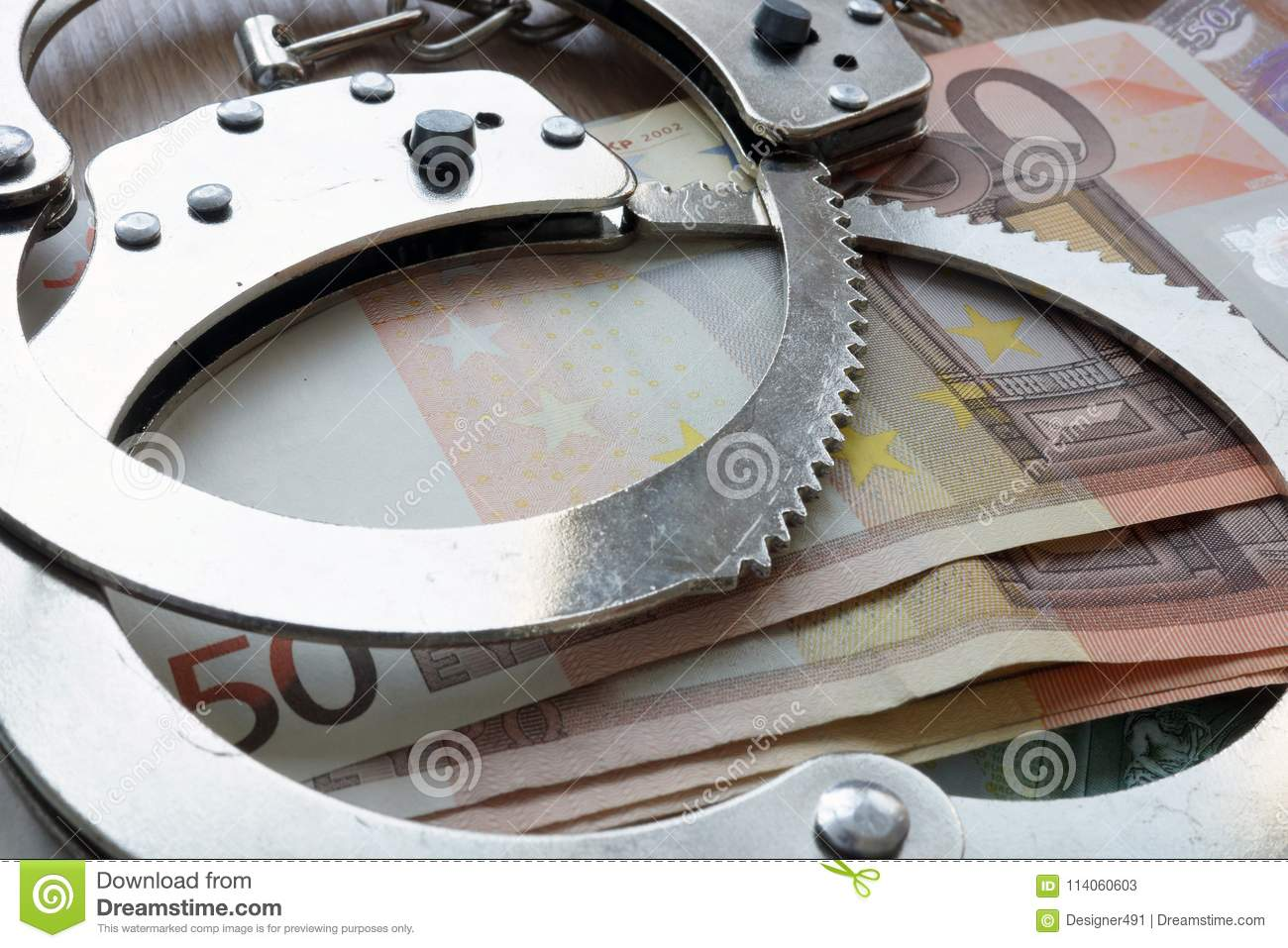Financial crime in Europe Union. Euro and handcuffs.