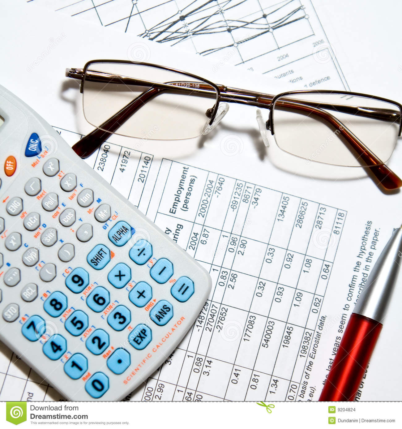 Financial: Calculator, Glasses And Papers Stock