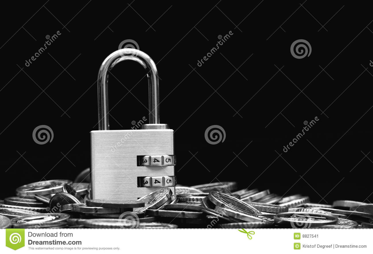 Financial security concept , a combination padlock on a pile of shiny