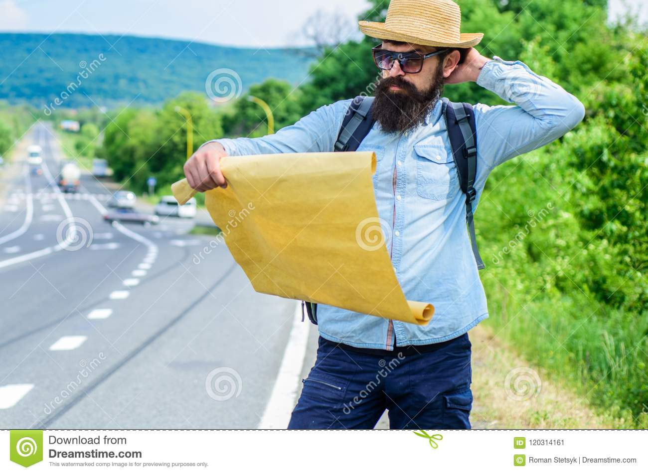 Find direction map large sheet of paper. Where should I go. Tourist backpacker map lost direction travelling. Around the