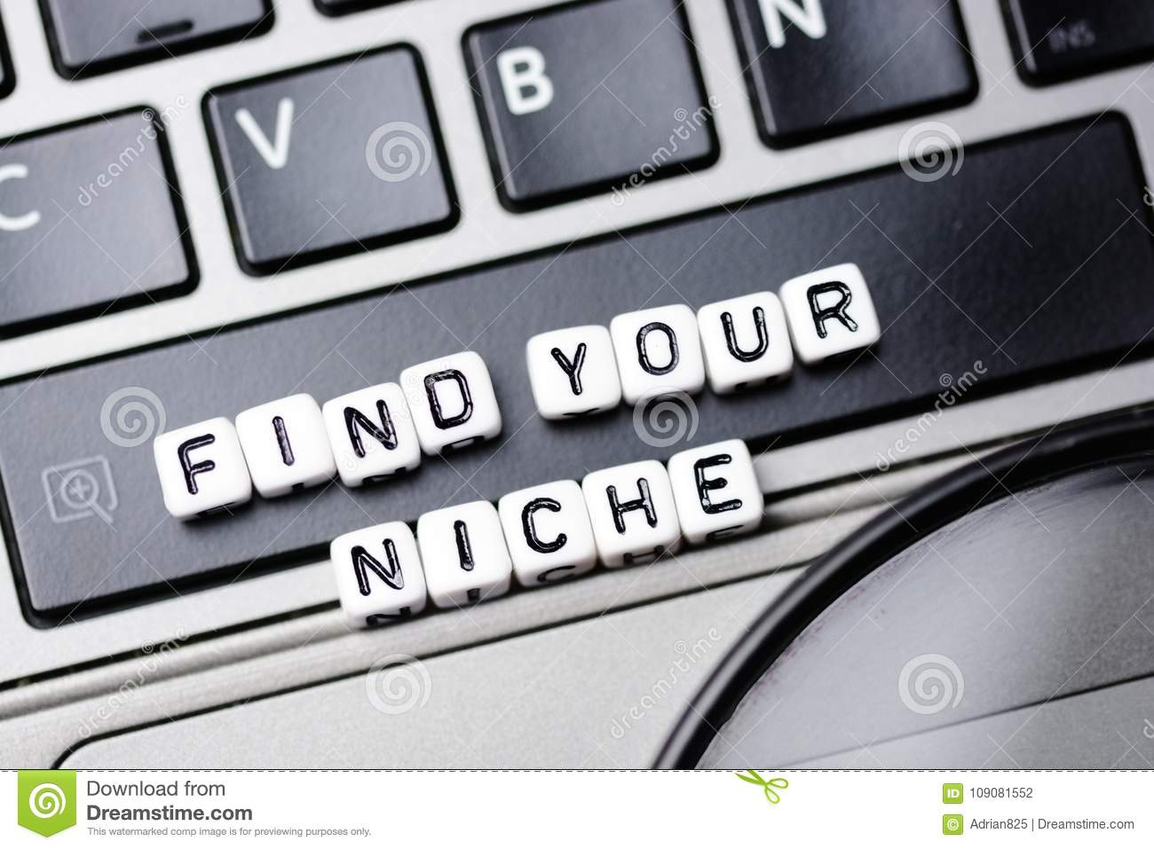 Find Your Niche Text With Small Letter Cubes On Laptop Keyboard