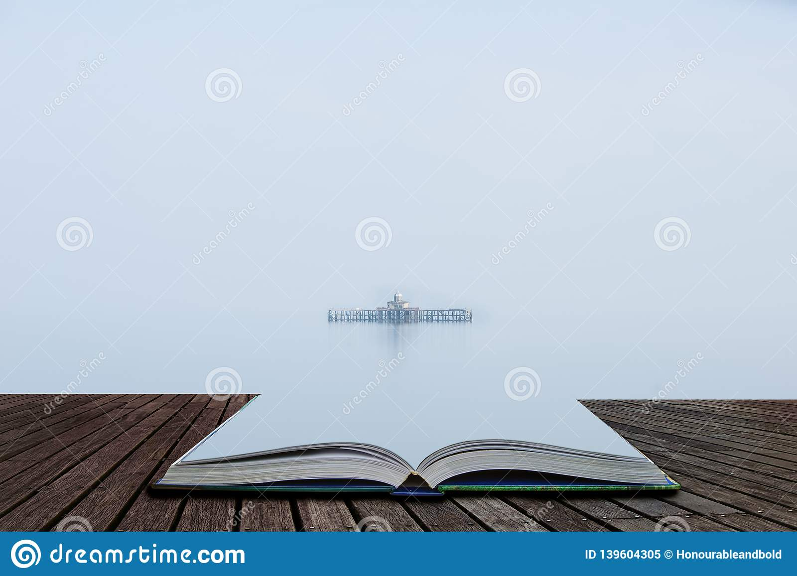 Fine art minimalist image of derelict pier remains at sea during foggy morning giving appearance of ruins floating coming out of