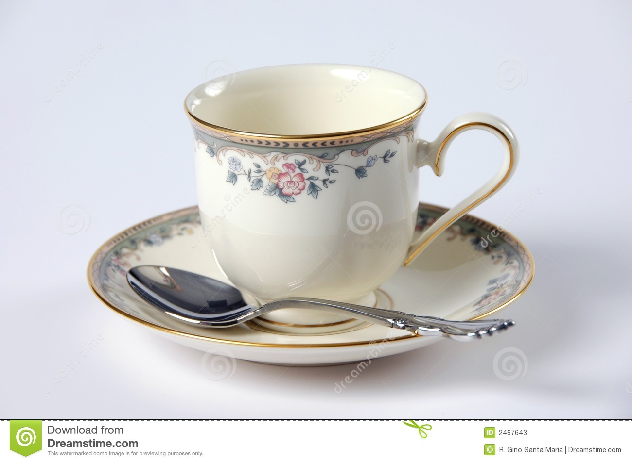 Fine China cup with saucer and spoon over a white background.