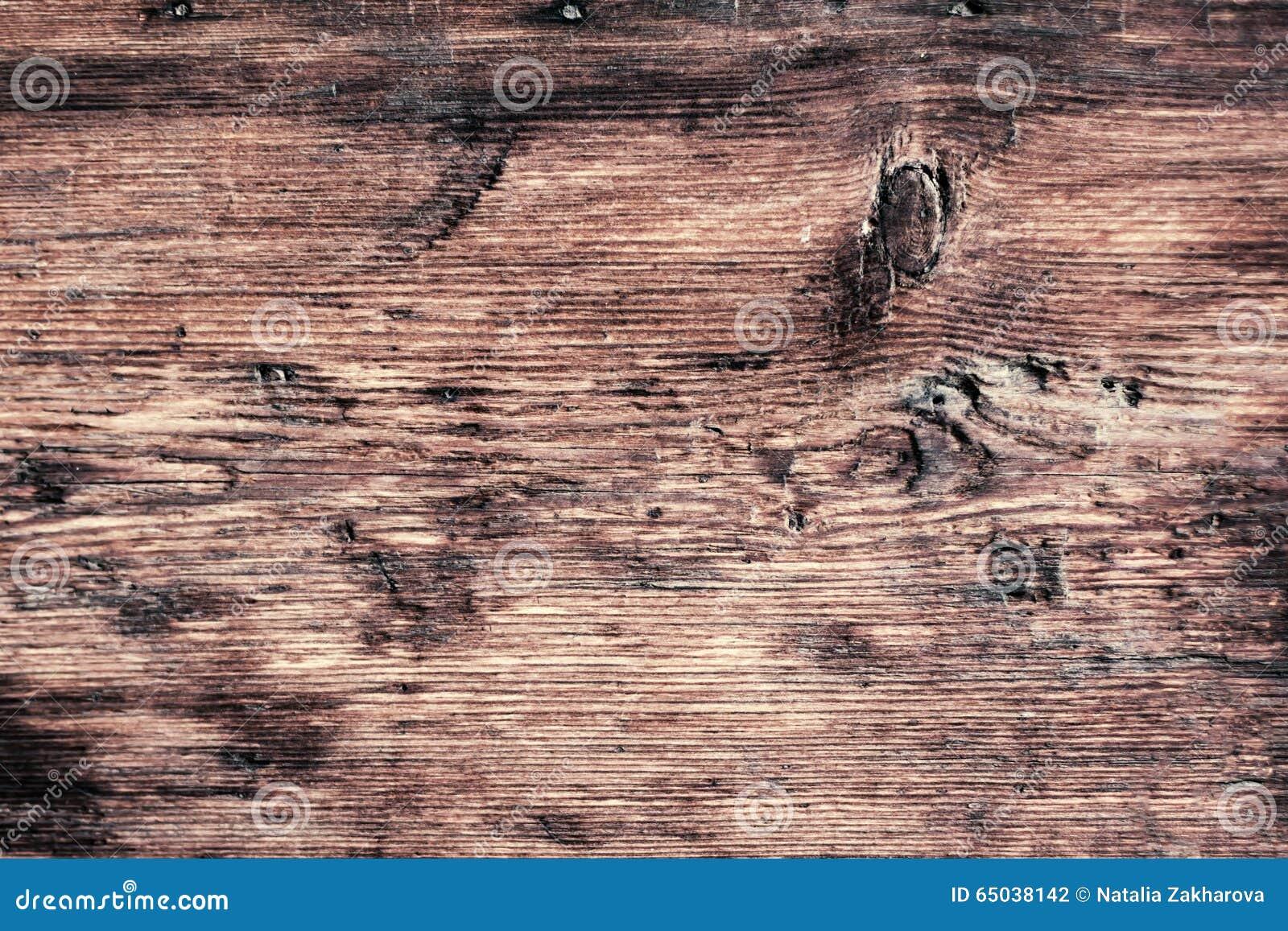 Fine di legno d annata scura di struttura su macro retro