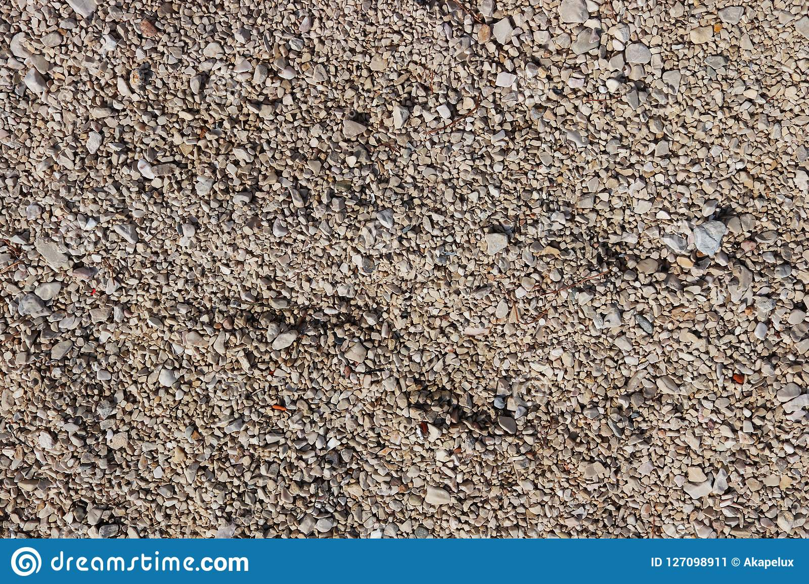 Fine pebbles of a brown shade. Beach ground. Natural material for design, decoration and construction. Sanded granite and hard min