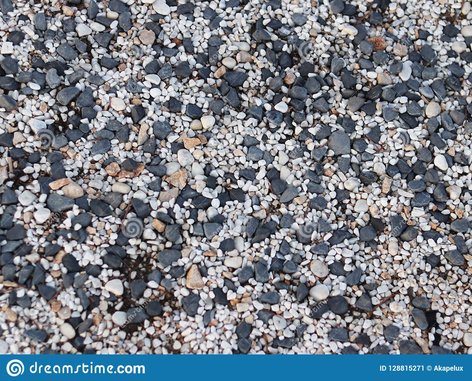 Fine pebbles of a gray shade. Beach ground. Natural material for design, decoration and construction. Sanded granite and hard mine