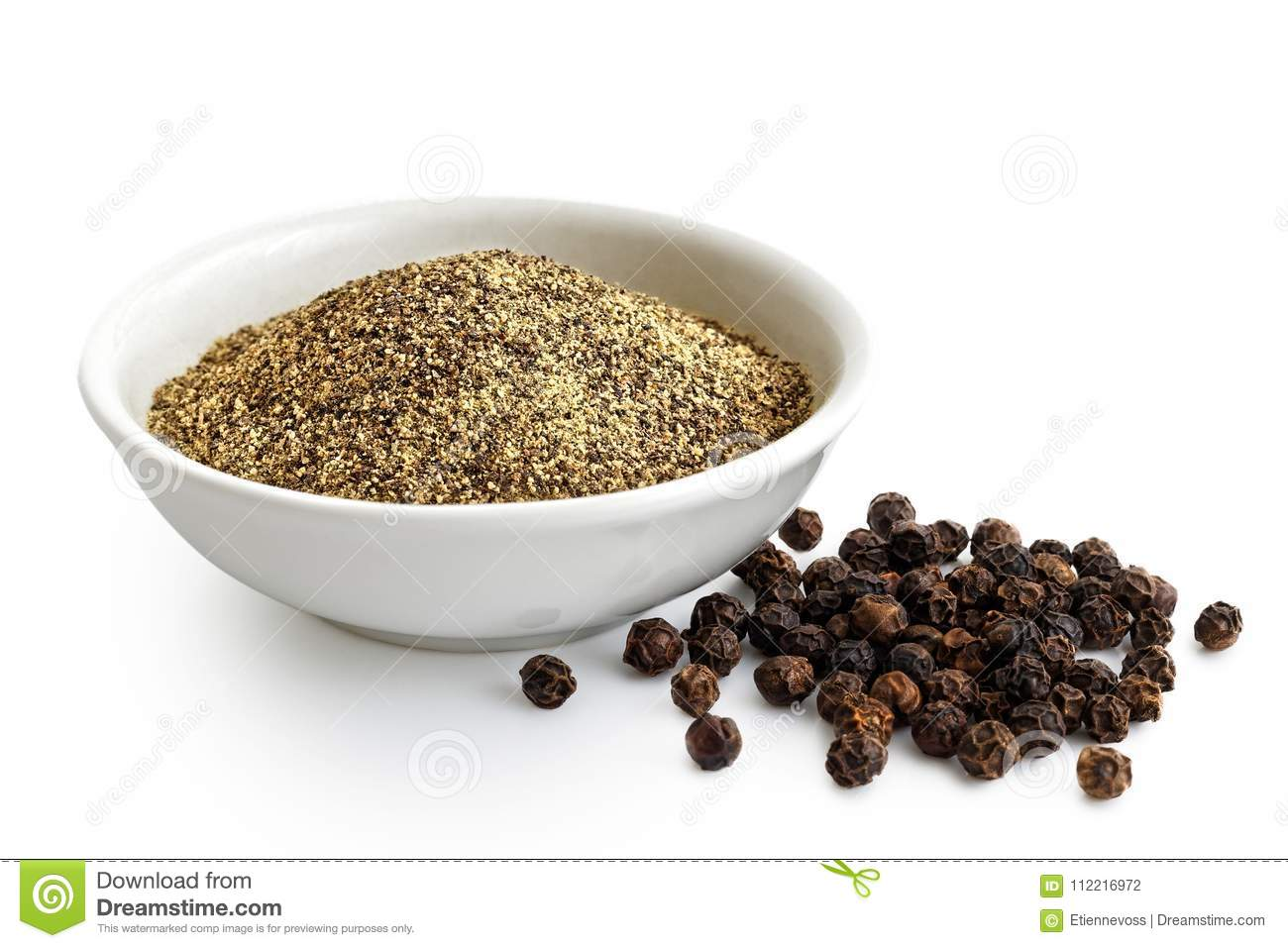 Finely ground black pepper in white ceramic bowl isolated on white. Black peppercorns.