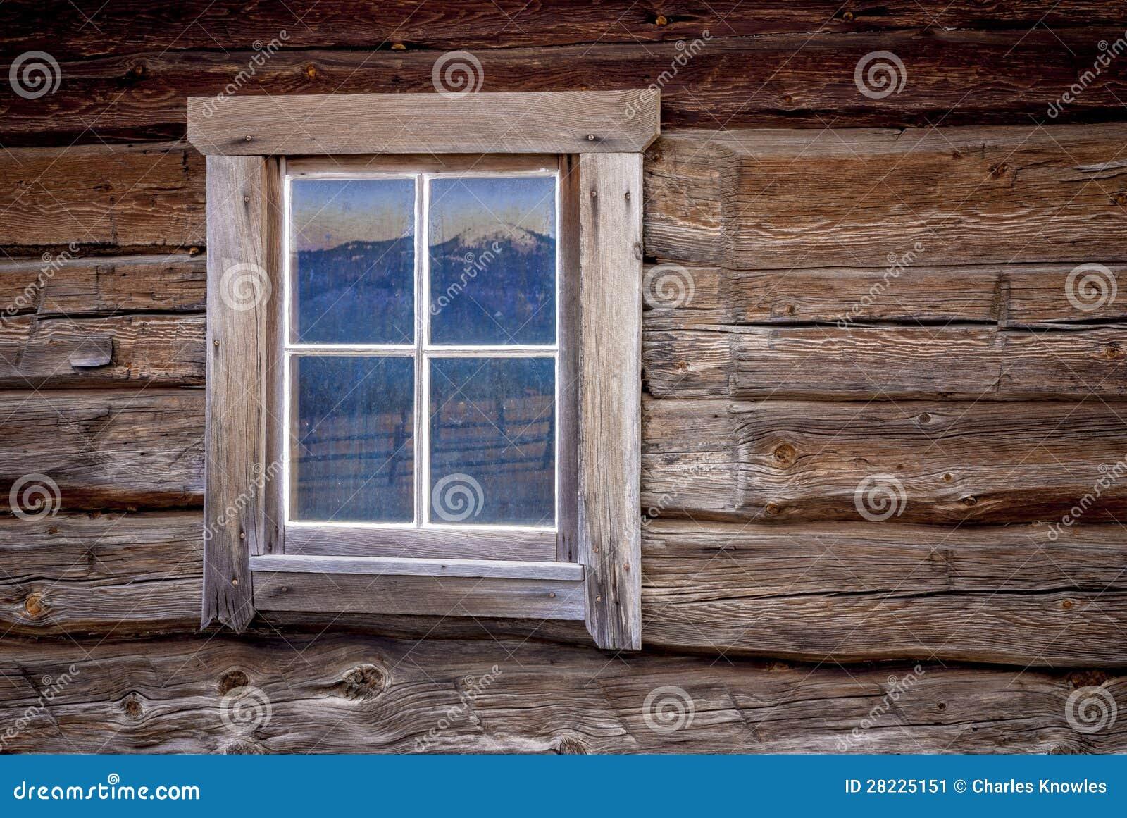 Finestra di cabina del libro macchina con la riflessione della montagna immagine stock - Libro la luce alla finestra ...