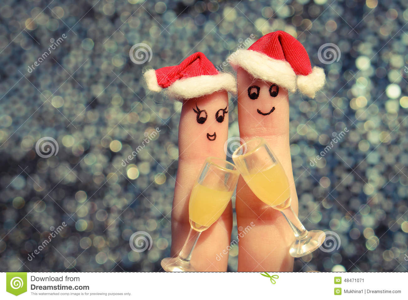 Finger art of a Happy couple. Couple making good cheer in the new year hats. Two glasses of champagne.