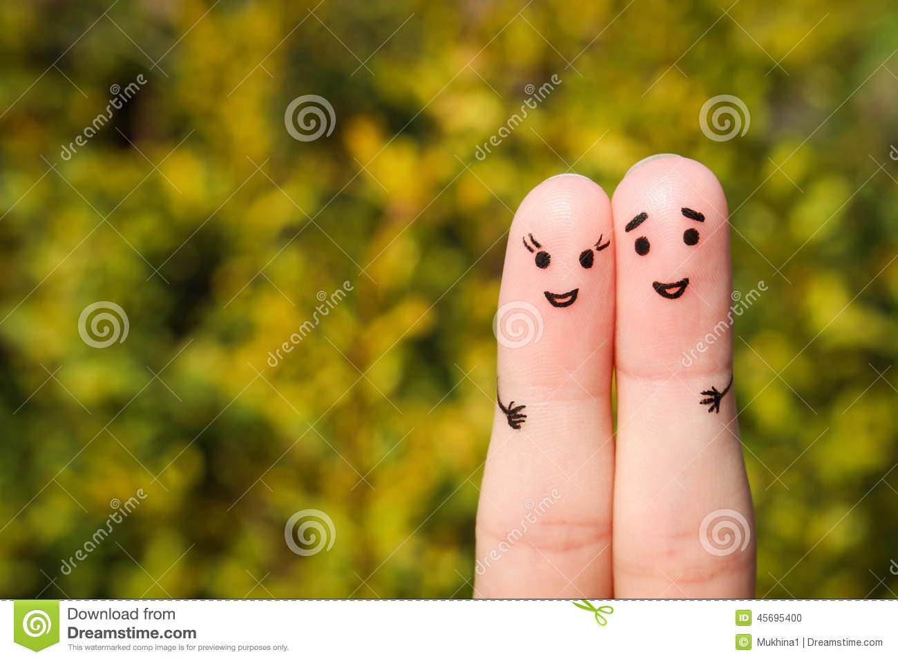 Finger Art Of A Happy Couple. A Man And A Woman Hug On The