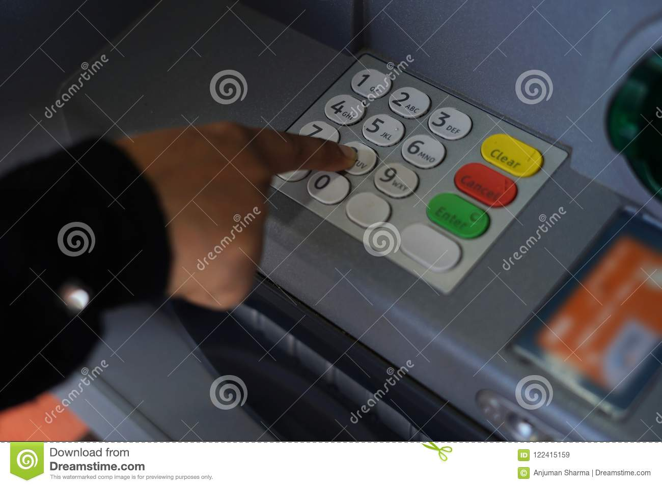 Person Pressing Pin Code On ATM Bank Machine Stock Image