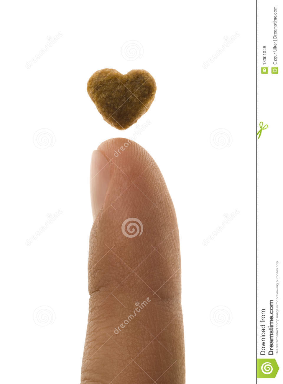 Finger And Heart Shaped Pet Food Royalty Free Stock Photos