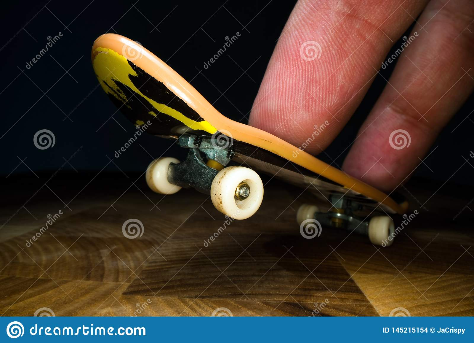 Fingerboard. A small skateboard for kids and teenagers to play with hand fingers. Youth culture, extreme sport