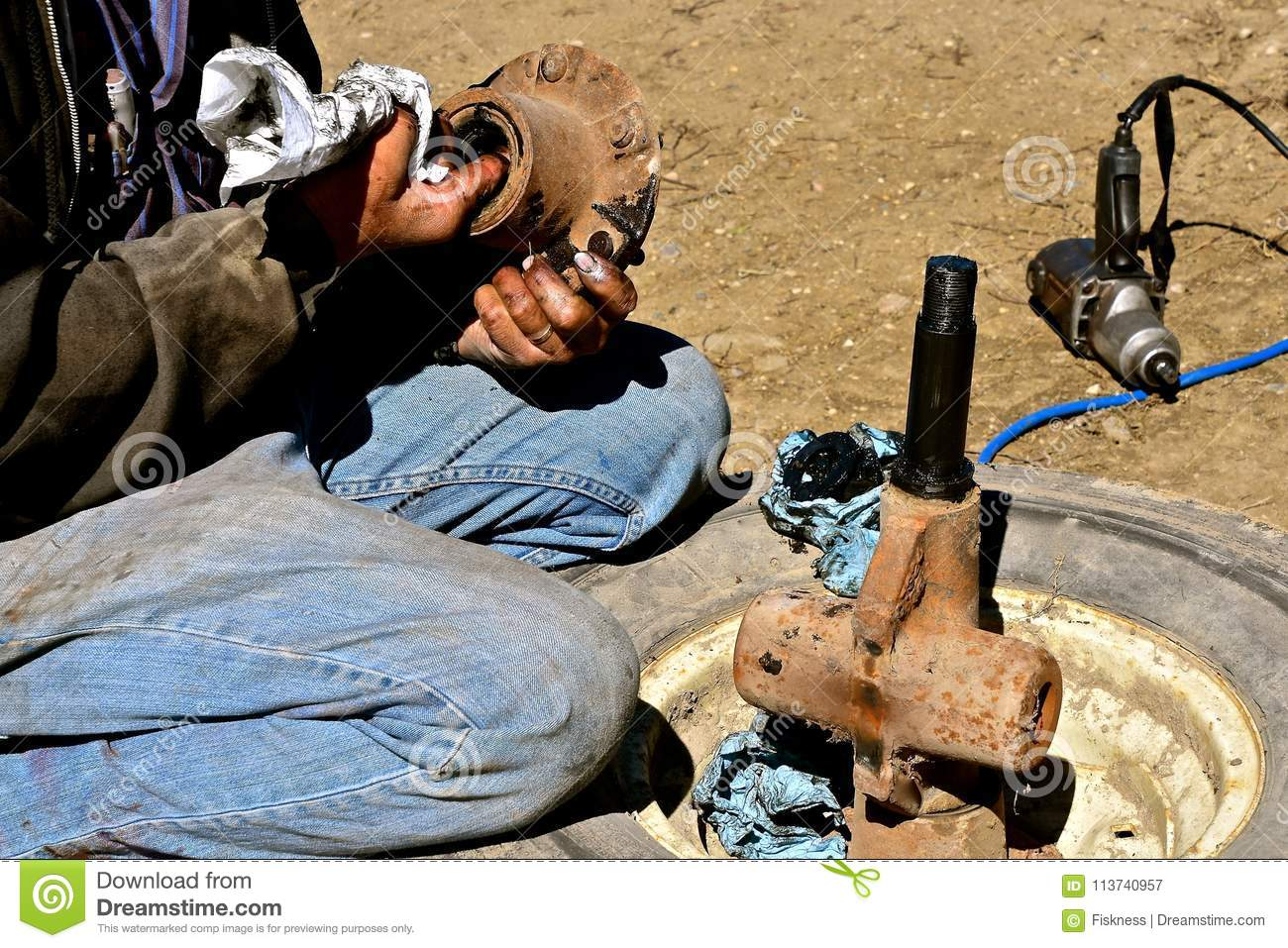 Greasy Hands Fixing Bearing Of A Wheel And Exle Stock Image