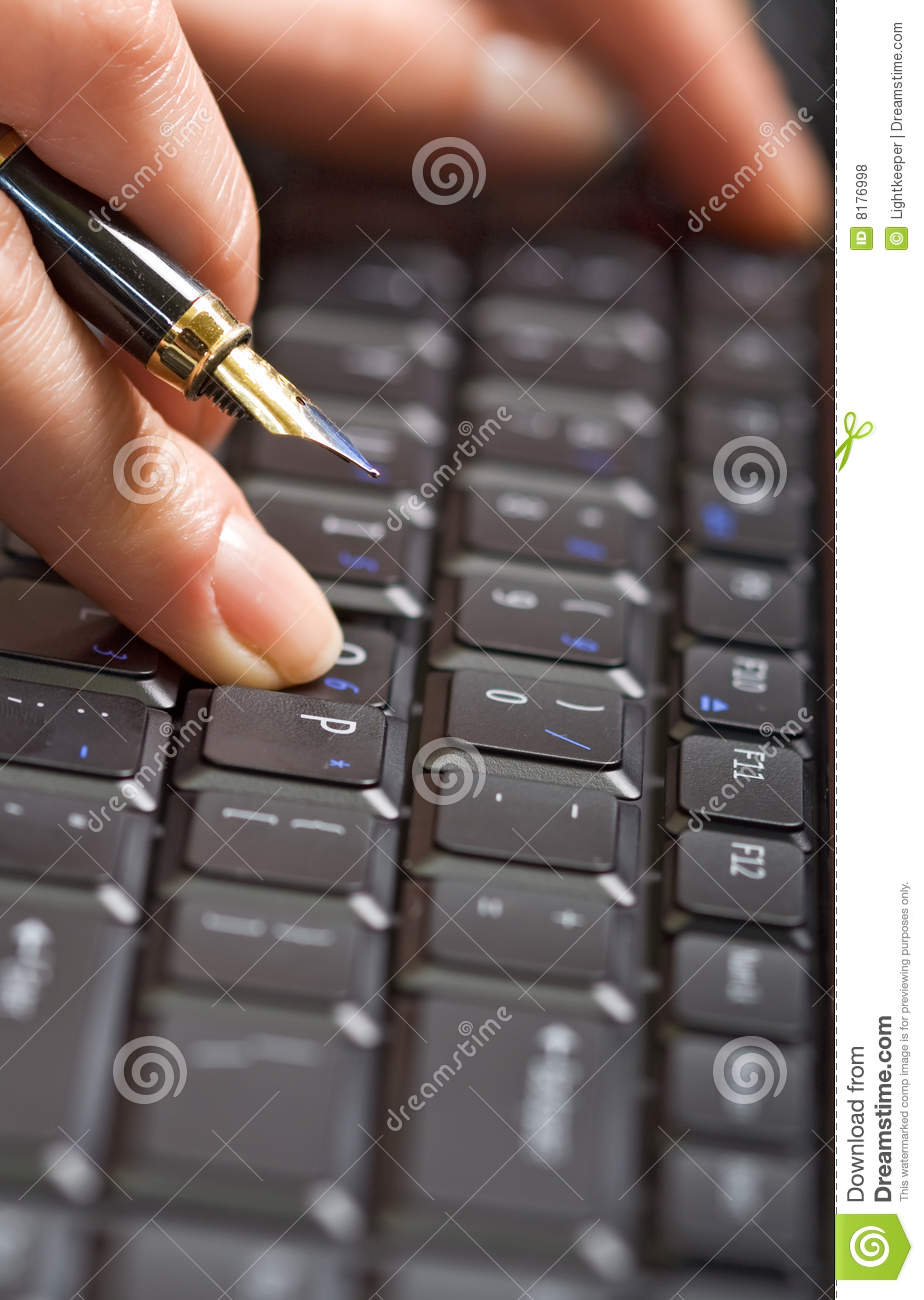 Fingers holding pen over keyboard