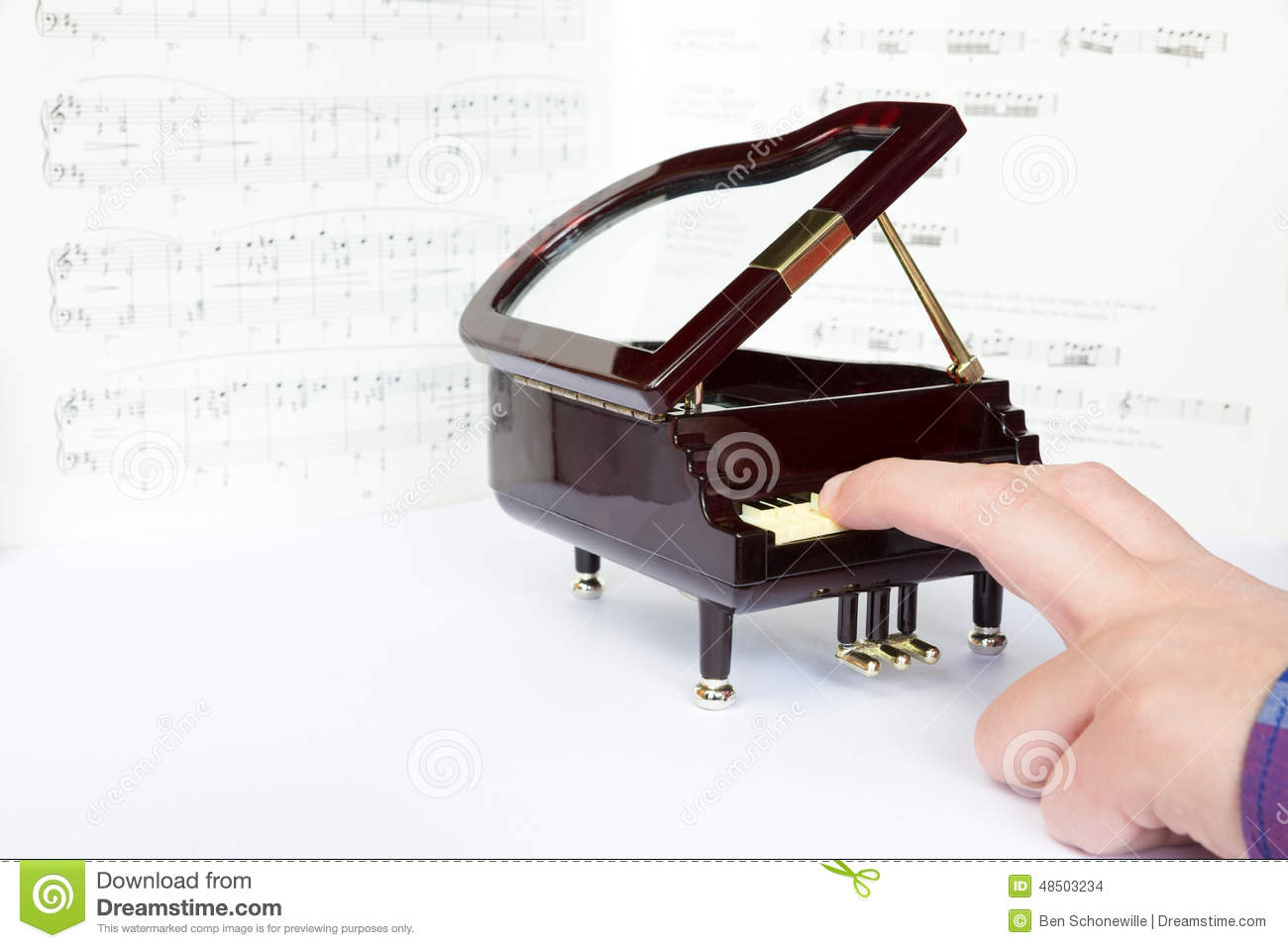 Fingers playing on small model of grand piano stock photo for Small grand piano