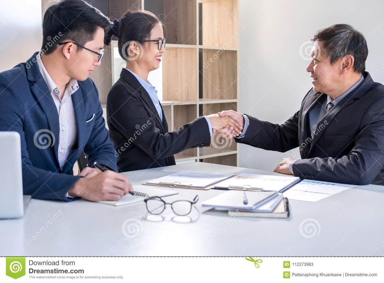 Finishing Up A Meeting Business Handshake After Discussing Good