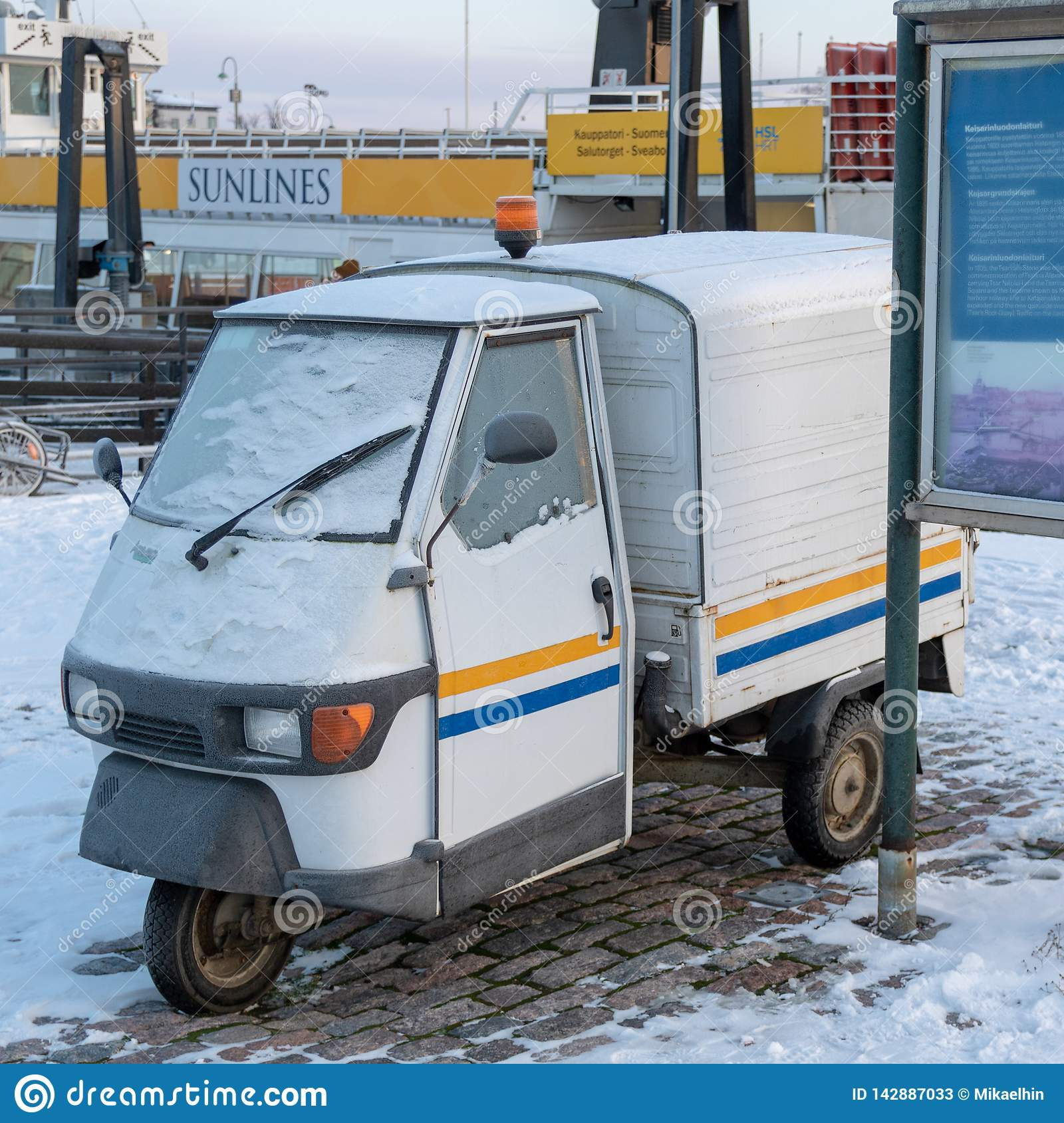 FINLAND, HELSINKI - JANUARY 2015: traditional vintage vehicle with three weels, parked next to harbor in the winter