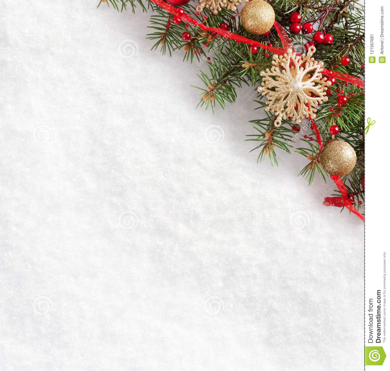 Fir Branch With Christmas Decorations On The Background Of