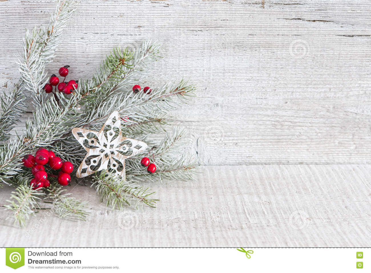 fir branch with christmas decorations on white rustic wooden background - Rustic Christmas Background