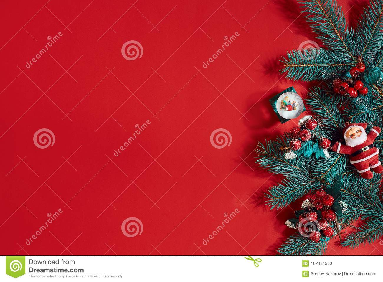Fir branches border on red background, good for christmas backdrop