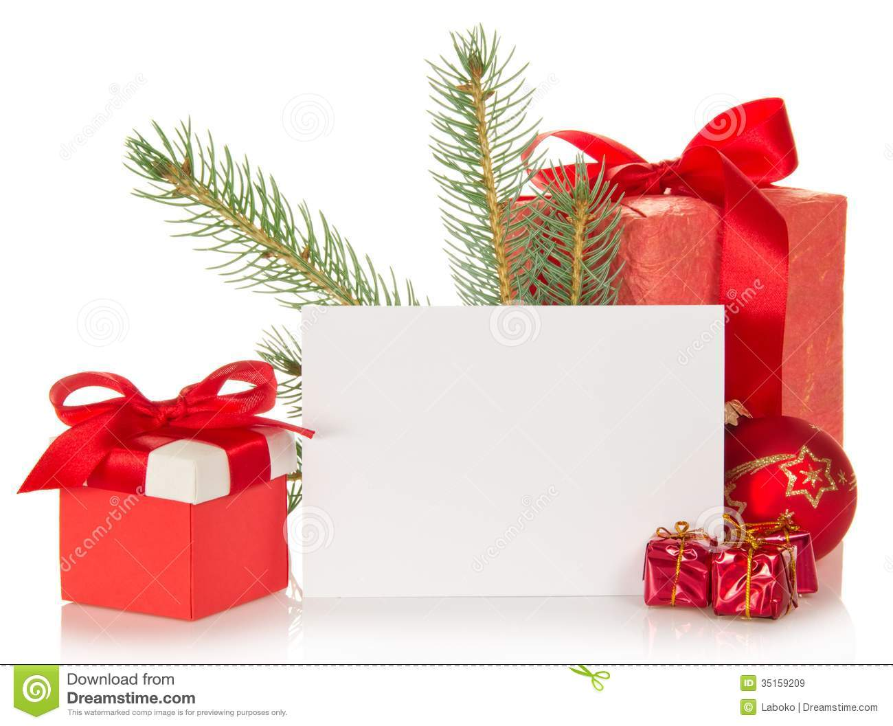 Fir-tree branch, Christmas toy, gift boxes and the empty card isolated ...