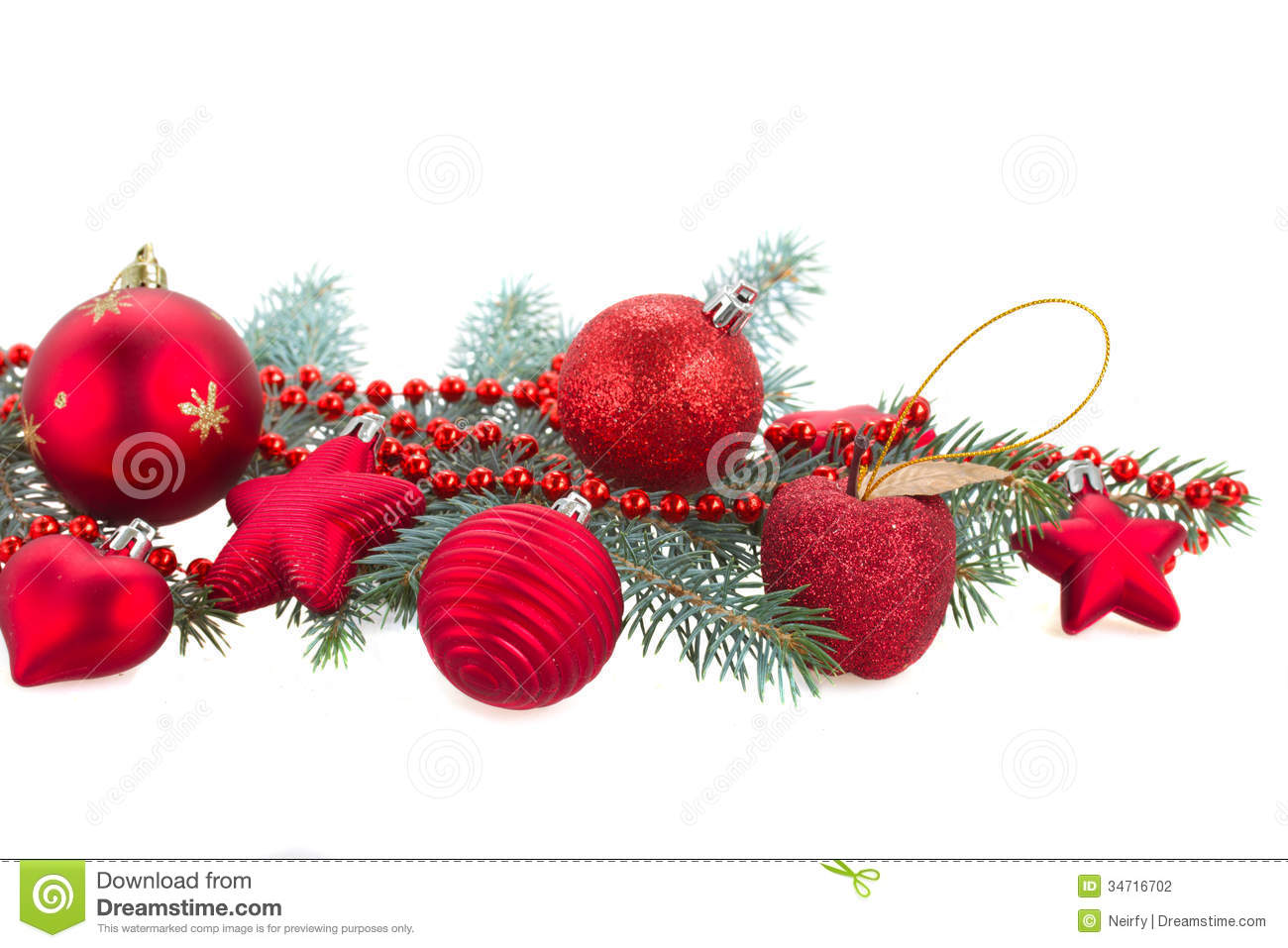 Fir Tree Branch And Red Christmas Decorations Stock Photo