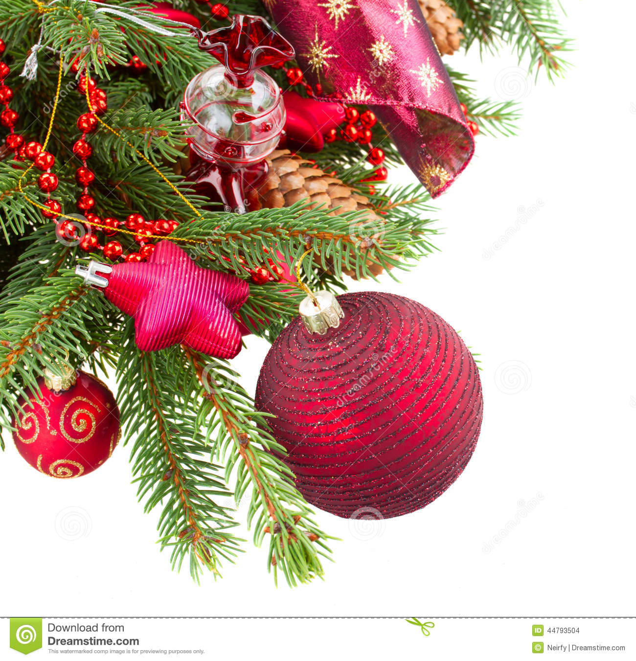 Fir tree with red christmas decorations and cones stock for Red white green christmas decor
