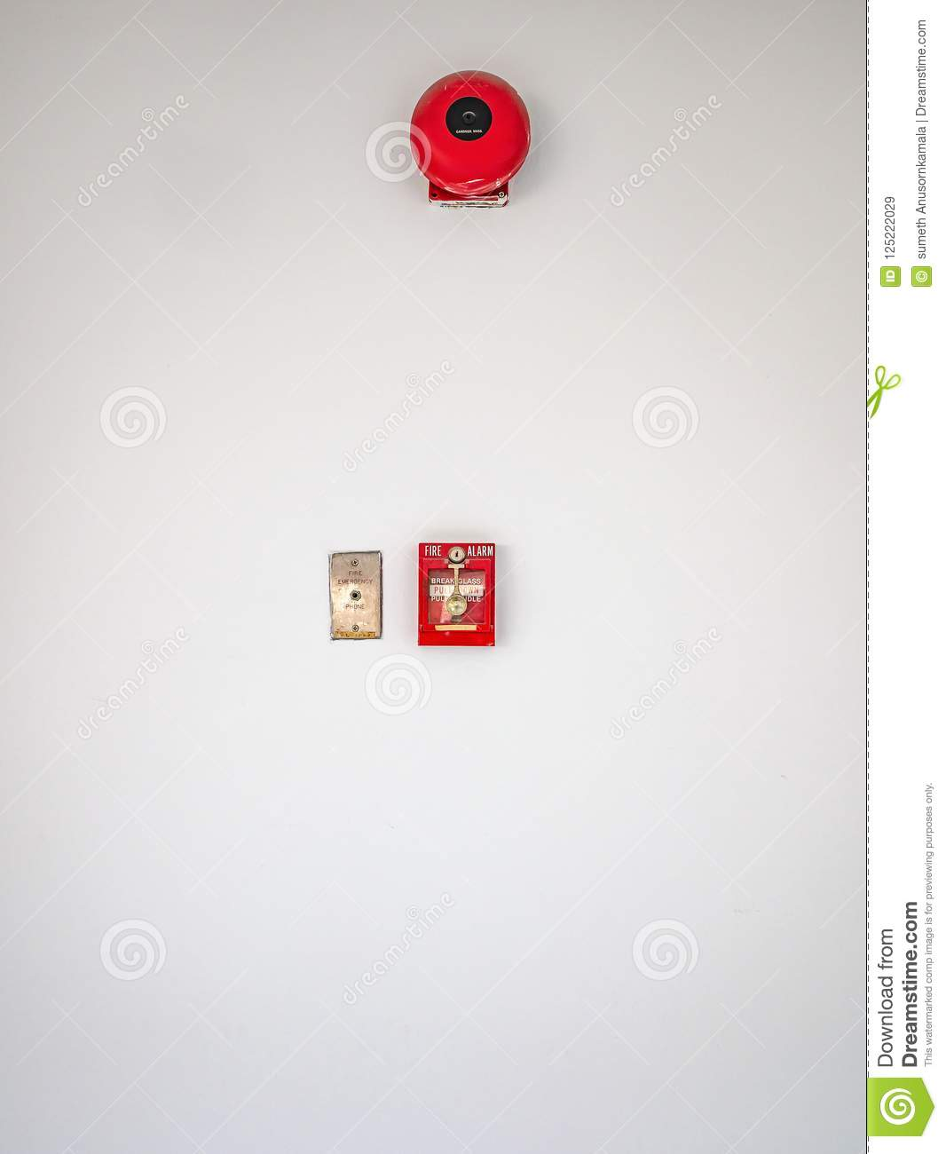 Fire alarm on white wall texture background