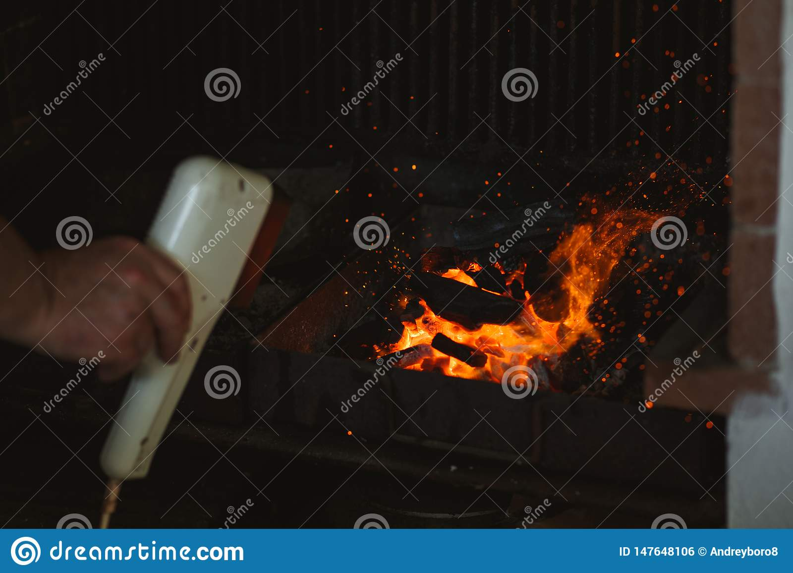 Fire Of A Barbecue With Burning Ashes On The Air Stock Photo