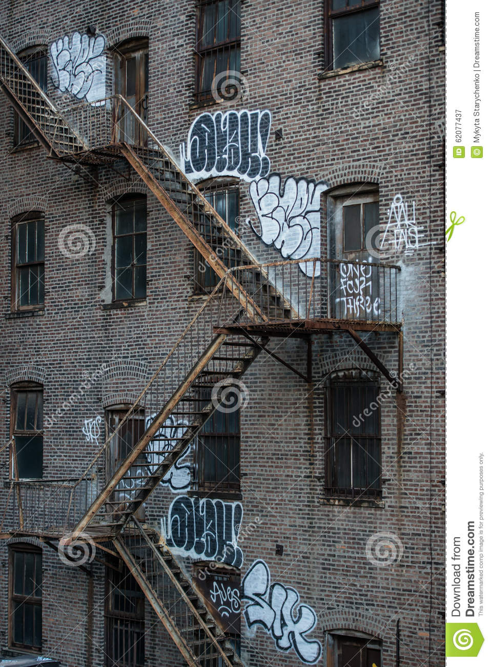 Fire Escape Stairs On An Old Building Exterior In New York, Manhattan
