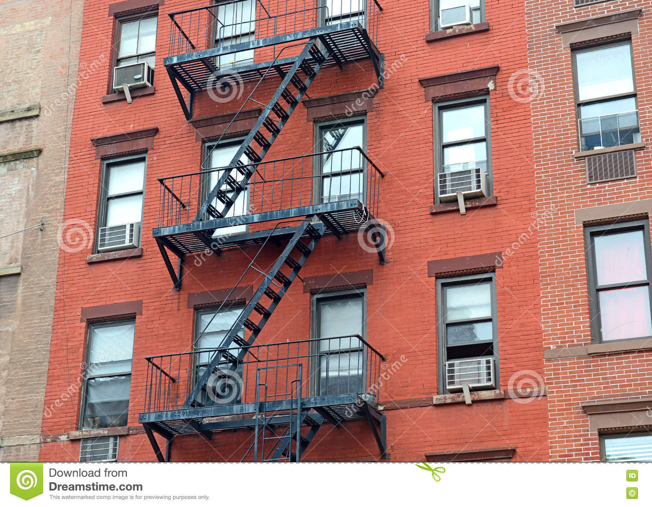 Fire Escape Stairway On Exterior Of Red Brick Walkup