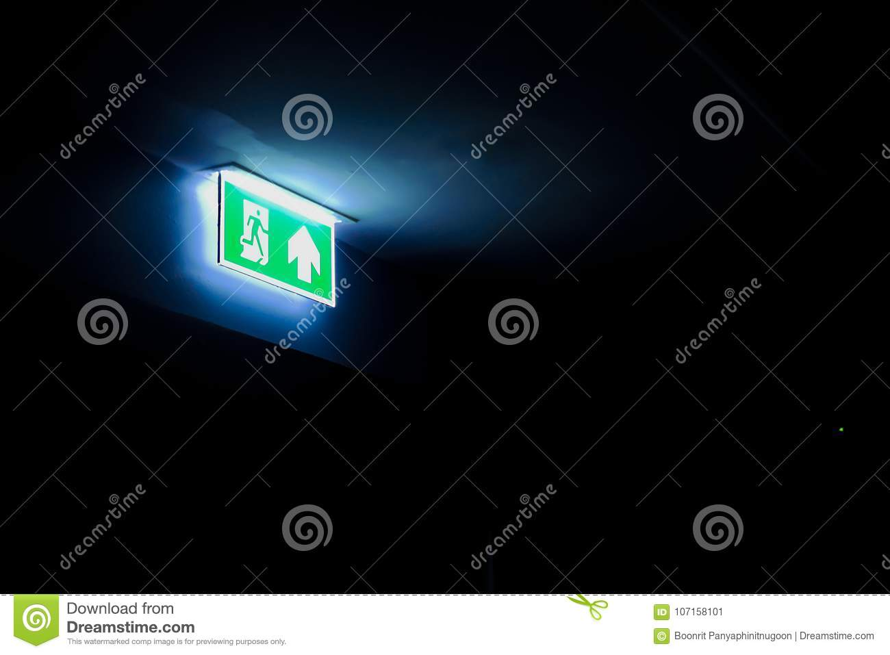 Fire Exit Sign In A Dark Room, With Copy Space Stock Image