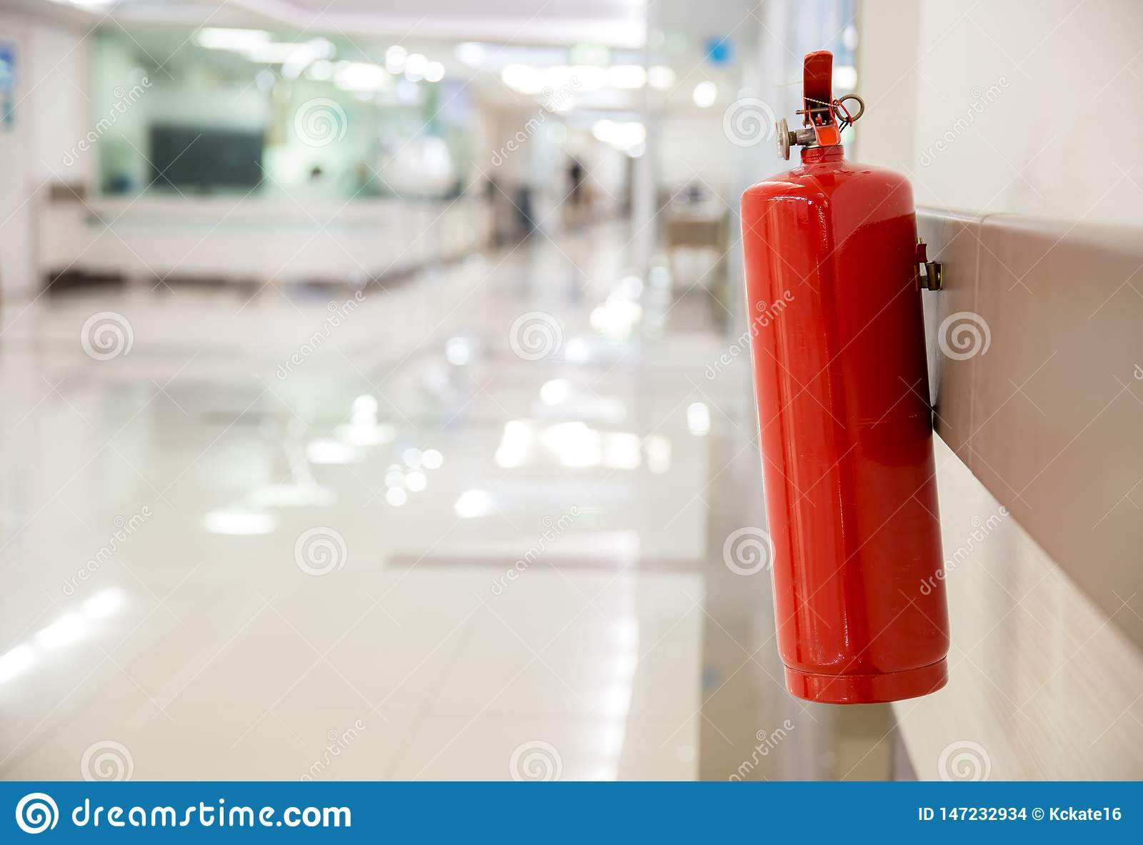 Fire extinguisher in the operating department . Install a fire extinguisher on the wall in building. Dry chemical powder fire exti